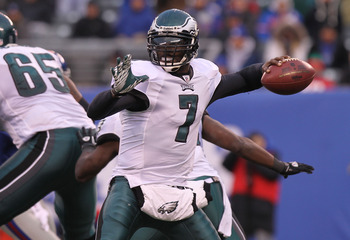 EAST RUTHERFORD, NJ - DECEMBER 19:  Michael Vick #7 of the Philadelphia Eagles passes against the New York Giants at New Meadowlands Stadium on December 19, 2010 in East Rutherford, New Jersey.  (Photo by Nick Laham/Getty Images)