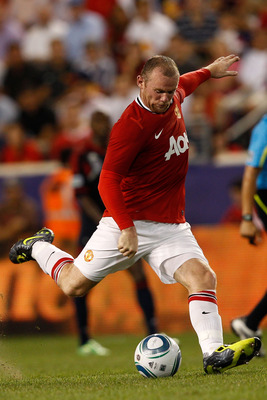HARRISON, NJ - JULY 27:  Wayne Rooney #10 of the Manchester United passes against the MLS All-Stars during the MLS All-Star Game at Red Bull Arena on July 27, 2011 in Harrison, New Jersey.  (Photo by Mike Stobe/Getty Images for the New York Red Bulls)