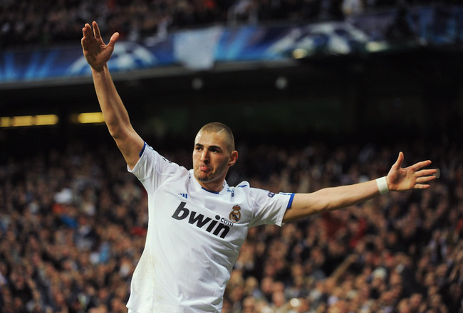 MADRID, SPAIN - MARCH 16:  Karim Benzema of Real Madrid celebrates after scoring Real's second goal during the UEFA Champions League round of 16 second leg match between Real Madrid and Lyon at Estadio Santiago Bernabeu on March 16, 2011 in Madrid, Spain.