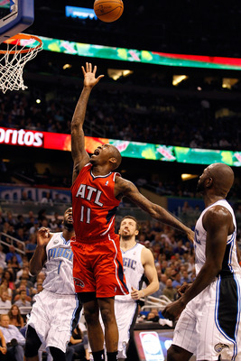 ORLANDO, FL - APRIL 16:  Jamal Crawford #11 of the Atlanta Hawks drives to the basket against the Orlando Magic during Game One of the Eastern Conference Quarterfinals of the 2011 NBA Playoffs on April 16, 2011 at the Amway Arena in Orlando, Florida.  NOT