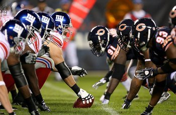 CHICAGO - AUGUST 22: The offensive line of the New York Giants waits to take on the defensive line of the Chicago Bears during a pre-season game on August 22, 2009 at Soldier Field in Chicago, Illinois. The Bears defeated the Giants 17-3. (Photo by Jonath