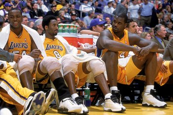 23 Nov 2000:  Shaquille O'Neal #34 of the Los Angeles Lakers sits on the bench as he looks over to Kobe Bryant #8 and Horace Grant #54 during a game against the Golden State Warriors at the STAPLES Center in Los Angeles, California. The Lakers defeated th