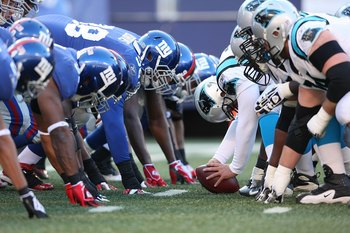 EAST RUTHERFORD, NJ - DECEMBER 27:  The New York Giants defense lines up against the Carolina Panthers offense at Giants Stadium on December 27, 2009 in East Rutherford, New Jersey.  (Photo by Nick Laham/Getty Images)