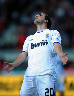 GIJON, SPAIN - NOVEMBER 14:  Gonzalo Higuain of Real Madrid reacts during the La Liga match between Sporting Gijon and Real Madrid at El Molinon Stadium on November 14, 2010 in Gijon, Spain.  (Photo by Denis Doyle/Getty Images)