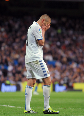MADRID, SPAIN - MARCH 12:  Karim Benzema of Real Madrid reacts during the La Liga match between Real Madrid and Hercules CF at Estadio Santiago Bernabeu on March 12, 2011 in Madrid, Spain.  (Photo by Denis Doyle/Getty Images)