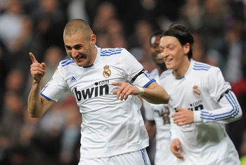 MADRID, SPAIN - MARCH 12:  Karim Benzema (L) of Real Madrid celebrates after scoring Real's opening goal  during the La Liga match between Real Madrid and Hercules CF at Estadio Santiago Bernabeu on March 12, 2011 in Madrid, Spain.  (Photo by Denis Doyle/