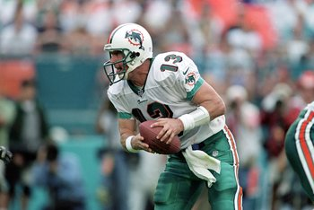 5 Dec 1999: Dan Marino #13 of the Miami Dolphins scrambles with the ball during the game against the Indianapolis Colts at the Pro Player Stadium in Miami, Florida. The Colts defeated the Dolphins 37-34. Mandatory Credit: Andy Lyons  /Allsport