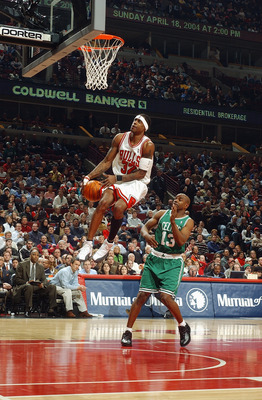 CHICAGO - FEBRUARY 12:  Eddie Robinson #32 of the Chicago Bulls shoots past Mike James #13 of the Boston Celtics during the game at the United Center on February 12, 2004 in Chicago, Illinois. The Bulls won 107-87. NOTE TO USER: User expressly acknowledge