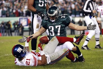 PHILADELPHIA - JANUARY 07:  Sean Considine #37 of the Philadelphia Eagles taunts Tiki Barber #21 of the New York Giants after tackling him during their NFC Wildcard Playoff game on January 7, 2007 at Lincoln Financial Field in Philadelphia, Pennsylvania.