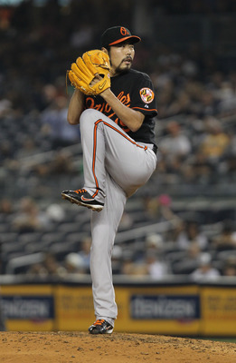 I mean, c'mon Getty Images, Koji pitched a full inning two days ago for the Rangers? And all you have are Orioles shots? Ah, it's okay, as along as we get to keep him.