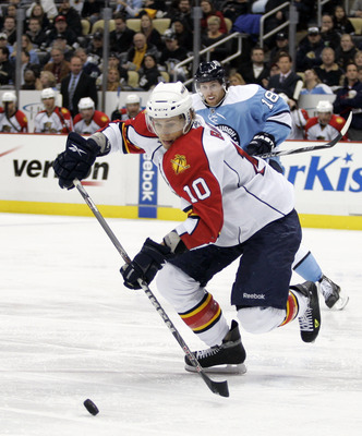 PITTSBURGH, PA - MARCH 27: David Booth #10 of the Florida Panthers handles the puck against the Pittsburgh Penguins at Consol Energy Center on March 27, 2011 in Pittsburgh, Pennsylvania. The Penguins defeated the Panthers 2-1 in a shootout. (Photo by Just