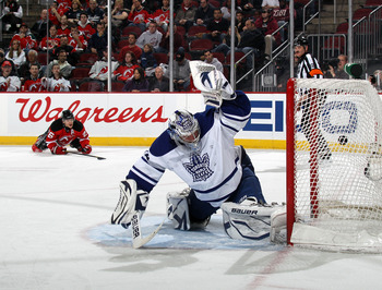 NEWARK, NJ - APRIL 06: A shot by Mattias Tedenby #21 of the New Jersey Devils (not shown) eludes James Reimer #34 of the Toronto Maple Leafs at 14:29 of the second period at the Prudential Center on April 6, 2011 in Newark, New Jersey.  (Photo by Bruce Be