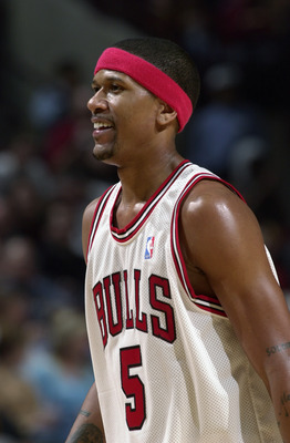 CHICAGO - MARCH 3:  Jalen Rose #5 of the Chicago Bulls smiles during the game against the Orlando Magic at the United Center on March 3, 2003 in Chicago, Illinois.  The Magic won 104-89.  NOTE TO USER: User expressly acknowledges and agrees that, by downl