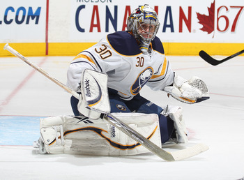 TORONTO, CANADA - MARCH 12:  Ryan Miller #30 of the Buffalo Sabres gets set to make a stop in a game against the Toronto Maple Leafs on March 12, 2011 at the Air Canada Centre in Toronto, Canada. The Leafs defeated the Sabres 4-3. (Photo by Claus Andersen