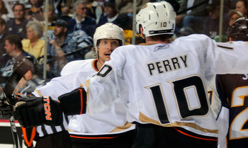 NASHVILLE, TN - APRIL 17:  Corey Perry #10 of the Anaheim Ducks congratulates teammate Teemu Selanne #8 on scoring a goal against the Nashville Predators in Game Three of the Western Conference Quarterfinals during the 2011 NHL Stanley Cup Playoffs at the