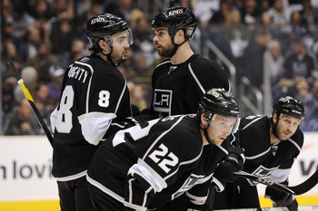 LOS ANGELES, CA - APRIL 25:  Drew Doughty #8 speaks with Willie Mitchell #33 of the Los Angeles Kings in the first period of game six of the Western Conference Quarterfinals against the San Jose Sharks during the 2011 NHL Stanley Cup Playoffs at Staples C