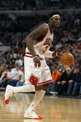 CHICAGO - DECEMBER 31:  Ben Wallace #3 of the Chicago Bulls moves the ball during the NBA game against Orlando Magic on December 31, 2007 at the United Center in Chicago, Illinois. NOTE TO USER: User expressly acknowledges and agrees that, by downloading