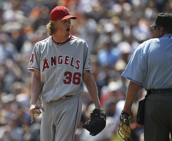 DETROIT - JULY 31:  Jered Weaver #36 of the Los Angeles Angels of Anaheim yells into the Tigers dugout after being throw out of the game by homeplate umpire Hunter Wendelstedt for throwing a pitch close to Alex Avila #13 of the   Detroit Tigers after Carl