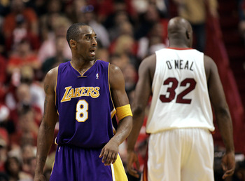MIAMI - DECEMBER 25:  Shaquille O'Neal #32 of the Miami Heat shows his back to Kobe Bryant #8 of the Los Angeles Lakers on December 25, 2005 at the American Airlines Arena in Miami, Florida. The Heat defeated the Lakers 97-92.  NOTE TO USER: User expressl