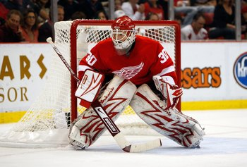 DETROIT - MAY 27:  Goalie Chris Osgood #30 of the Detroit Red Wings tends goal against the Chicago Blackhawks during Game Five of the Western Conference Championship Round of the 2009 Stanley Cup Playoffs on May 27, 2009 at Joe Louis Arena in Detroit, Mic