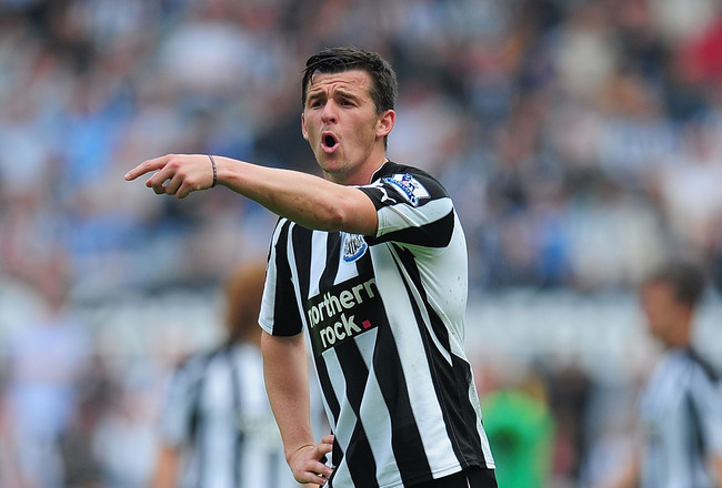 NEWCASTLE UPON TYNE, ENGLAND - MAY 07:  Newcastle player Joey Barton makes a point during the Barclays  Premier League game between Newcastle United and Birmingham City at St James' Park on May 7, 2011 in Newcastle upon Tyne, England.  (Photo by Stu Forst