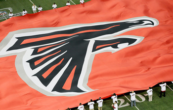 ATLANTA, GA - JANUARY 15:  A giant flag with the Atlanta Falcons logo is seen on the field against the Green Bay Packers during their 2011 NFC divisional playoff game at Georgia Dome on January 15, 2011 in Atlanta, Georgia.  (Photo by Kevin C. Cox/Getty I