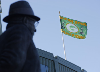 GREEN BAY, WI - FEBRUARY 08:  A Green Bay Packers Super Bowl Champion flag flies over Lambeau Field on February 8, 2011 in Green Bay, Wisconsin.  (Photo by Matt Ludtke/Getty Images)