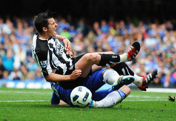 LONDON, ENGLAND - MAY 15:  Joey Barton (front) of Newcastle United is fouled by Frank Lampard of Chelsea during the Barclays Premier League match between Chelsea and Newcastle United at Stamford Bridge on May 15, 2011 in London, England.  (Photo by Michae
