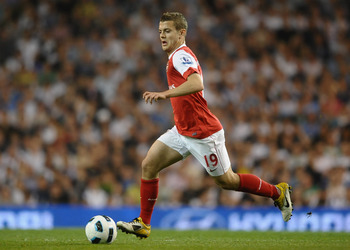 LONDON, ENGLAND - APRIL 20:  Jack Wilshere of Arsenal runs with the ball during the Barclays Premier League match between Tottenham Hotspur and Arsenal at White Hart Lane on April 20, 2011 in London, England.  (Photo by Laurence Griffiths/Getty Images)