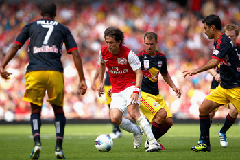 LONDON, ENGLAND - JULY 31:  Tomas Rosicky of Arsenal tries to make his way through the New York Red Bulls defence during the during the Emirates Cup match between Arsenal and New York Red Bulls at the Emirates Stadium on July 31, 2011 in London, England.