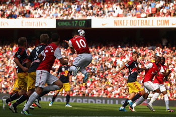 LONDON, ENGLAND - JULY 31:  Robin van Persie of Arsenal heads in the opening goal during the Emirates Cup match between Arsenal and New York Red Bulls at the Emirates Stadium on July 31, 2011 in London, England.  (Photo by Richard Heathcote/Getty Images)