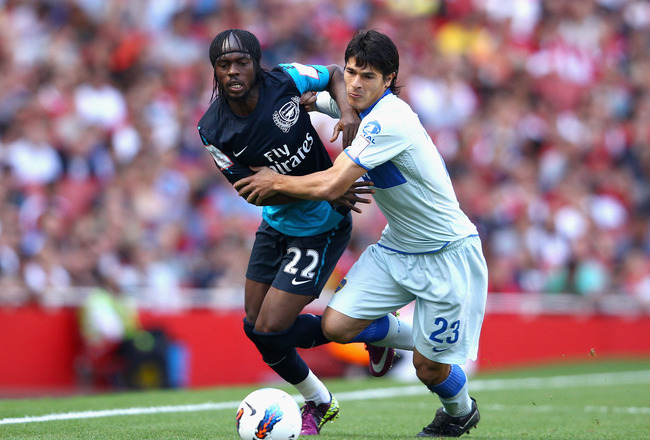 LONDON, ENGLAND - JULY 30:  Gervinho of Arsenal and Facundo Roncaglia of Boca Juniors battle for the ball during the Emirates Cup match between Arsenal and Boca Juniors at the Emirates Stadium on July 30, 2011 in London, England.  (Photo by Richard Heathc