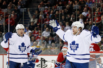MONTREAL, CANADA - FEBRUARY 24:  Phil Kessel #81 of the Toronto Maple Leafs celebrates his second first period goal during the NHL game against the Montreal Canadiens at the Bell Centre on February 24, 2011 in Montreal, Quebec, Canada.  (Photo by Richard