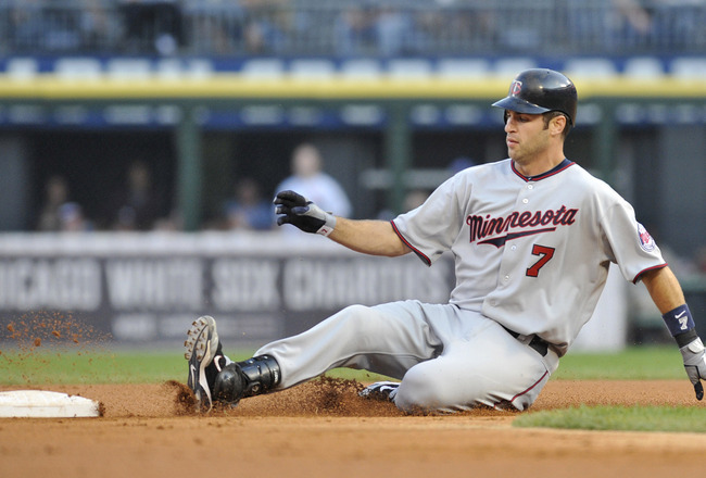 CHICAGO, IL - JULY 08:  Joe Mauer #7 of the Minnesota Twins slides into second base with a double against the Chicago White Sox in the first inning on July 8, 2011 at U.S. Cellular Field in Chicago, Illinois.  (Photo by David Banks/Getty Images)