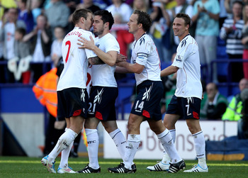 BOLTON, ENGLAND - APRIL 24:  Tamir Cohen of Bolton Wanderers is congratulated by his team mates after scoring the winning goal during the Barclays Premier League match between Bolton Wanderers and Arsenal at the Reebok Stadium on April 24, 2011 in Bolton,