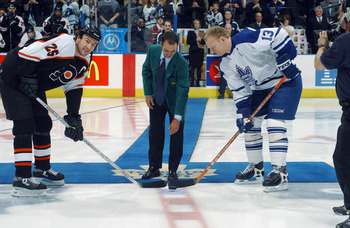TORONTO - APRIL 14:  Mike Weir 2003 Masters Champion drops the puck for the ceremonial faceoff between Keith Primeau #25 of the Philadelphia Flyers and Mats Sundin #13 of the Toronto Maple Leafs in the first round of the Stanley Cup playoffs at Air Canada