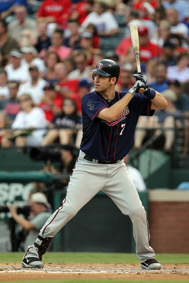 ARLINGTON, TX - JULY 28:  Joe Mauer #7 of the Minnesota Twins at Rangers Ballpark in Arlington on July 28, 2011 in Arlington, Texas.  (Photo by Ronald Martinez/Getty Images)