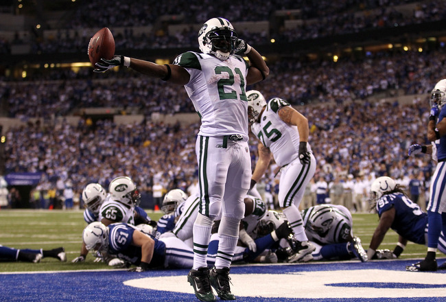 INDIANAPOLIS, IN - JANUARY 08:  LaDainian Tomlinson #21 of the New York Jets celebrates after he scored a 1-yard touchdown in the fourth quarter against the Indianapolis Colts during their 2011 AFC wild card playoff game at Lucas Oil Stadium on January 8,