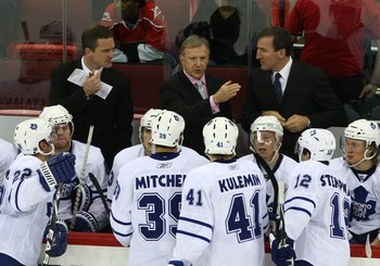 RALEIGH, NC - NOVEMBER 19: Head Coach Ron Wilson (C) of the Toronto Maple Leafs gives his players instructions late in the third period in their game against the Carolina Hurricanes at the RBC Center on November 19, 2009 in Raleigh, North Carolina. The Hu