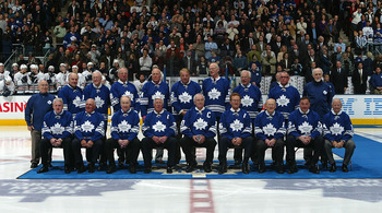 TORONTO - FEBRUARY 17:  Members of the 1967 Toronto Maple Leafs pose for a team photo at centre ice as the '67 Maple Leafs are honored prior to the Edmonton Oilers playing the Toronto Maple Leafs during their NHL game at the Air Canada Centre on February