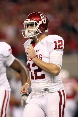ARLINGTON, TX - DECEMBER 04:  Quarterback Landry Jones #12 of the Oklahoma Sooners drops back to pass against the Nebraska Cornhuskers during the Big 12 Championship at Cowboys Stadium on December 4, 2010 in Arlington, Texas.  (Photo by Ronald Martinez/Ge