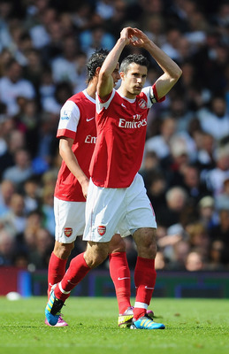 LONDON, ENGLAND - MAY 22:  Robin Van Persie of Arsenal celebrates his goal during the Barclays Premier League match between Fulham and Arsenal at Craven Cottage on May 22, 2011 in London, England.  (Photo by Clive Mason/Getty Images)