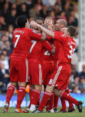 LONDON, ENGLAND - MAY 09:  Maxi Rodriguez of Liverpool is mobbed by his team mates after scoring the second goal during the Barclays Premier League match between Fulham and Liverpool at Craven Cottage on May 9, 2011 in London, England.  (Photo by Scott He