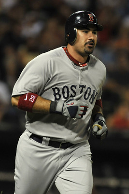CHICAGO, IL - JULY 30:  Adrian Gonzalez #28 of the Boston Red Sox hits a two-run home run in the ninth inning against the Chicago White Sox on July 30, 2011 at U.S. Cellular Field in Chicago, Illinois.  (Photo by David Banks/Getty Images)