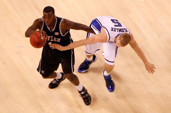 INDIANAPOLIS - APRIL 05:  Shelvin Mack #1 of the Butler Bulldogs moves the ball as Mason Plumlee #5 of the Duke Blue Devils goes for a steal in the first half during the 2010 NCAA Division I Men's Basketball National Championship game at Lucas Oil Stadium