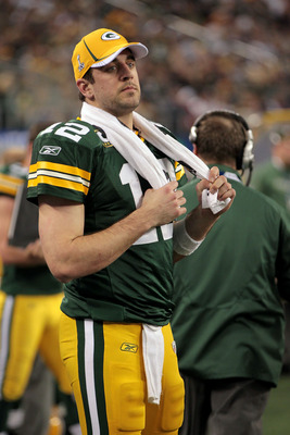 ARLINGTON, TX - FEBRUARY 06:  Quarterback Aaron Rodgers #12 of the Green Bay Packers looks on against the Pittsburgh Steelers during Super Bowl XLV at Cowboys Stadium on February 6, 2011 in Arlington, Texas. The Packers won 31-25. (Photo by Jamie Squire/G
