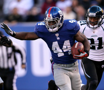 EAST RUTHERFORD, NJ - NOVEMBER 28:  Ahmad Bradshaw #44 of the New York Giants makes a break past Don Carey #22 of the Jacksonville Jaguars at New Meadowlands Stadium on November 28, 2010 in East Rutherford, New Jersey.  (Photo by Chris McGrath/Getty Image