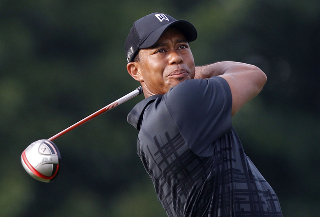 AKRON, OH - AUGUST 02:  Tiger Woods hits his tee shot on the eighth hole during a practice round for the World Golf Championships Bridgestone Invitational at Firestone Country Club on August 2, 2011 in Akron, Ohio.  (Photo by Matt Sullivan/Getty Images)
