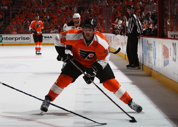 PHILADELPHIA, PA - APRIL 26:  Darroll Powe #36 of the Philadelphia Flyers controls the puck against the Buffalo Sabres in Game Seven of the Eastern Conference Quarterfinals during the 2011 NHL Stanley Cup Playoffs at Wells Fargo Center on April 26, 2011 i