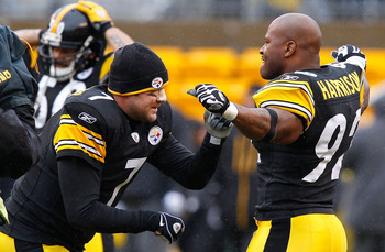 PITTSBURGH - DECEMBER 12:  Ben Roethlisberger #7 and James Harrison #92 of the Pittsburgh Steelers go through their pregame ritual prior to the game against the Cincinnati Bengals on December 12, 2010 at Heinz Field in Pittsburgh, Pennsylvania.  (Photo by